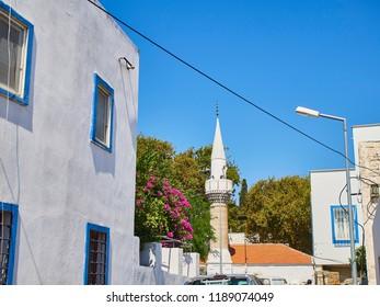 Minaret of Turkkuyusu Cami mosque, view from Turgut Reis street. Bodrum. Mugla Province, Turkey.