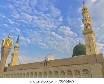 Minarets and Domes At Prophet Muhammad Mosque In Medina with clouds and blue sky