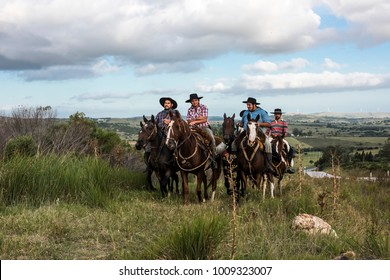 Minas, Uruguay: Marth 30, 2017 - The gauchos ride from one cattle pasture to another, along the road to Minas, Maldonado Department