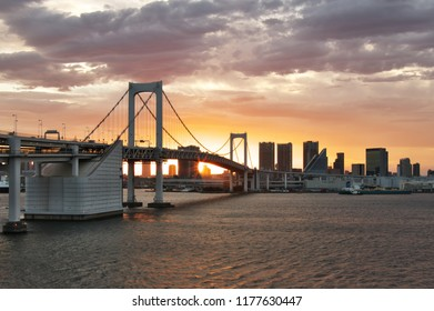Minato - ku, Tokyo/ Japan - September 7, 2018 : Sunset through The Tokyo  Rainbow Bridge.