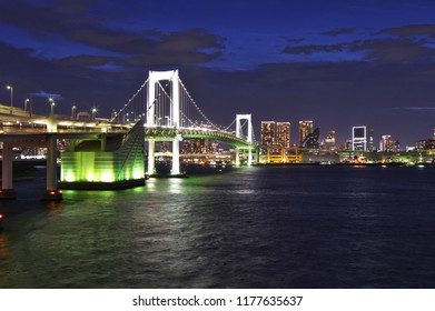 Minato - ku, Tokyo / Japan - September 7, 2018 : Panorama night view of The Tokyo Rainbow bridge and Tokyo Bay with cityscape at night.