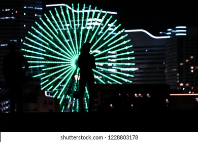 Minato Mirai of night view and the people of the silhouette
