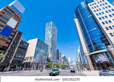 """MINATO, TOKYO / JAPAN - APRIL 23 2017 : Scenery of intersection of """"Minami Aoyama 5-chome"""" in Minato-ku, Tokyo. Luxury brand shops and other fashionable modern buildings are lining up."""