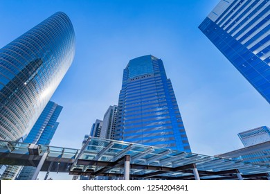 "MINATO, TOKYO / JAPAN - NOVEMBER 15 2018 : Scenery of office building in front of ""Shinagawa"" station. There is a skyscraper of ""SHINAGAWA INTERCITY""."