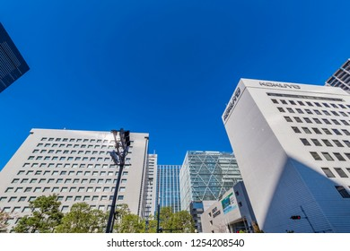 "MINATO, TOKYO / JAPAN - NOVEMBER 15 2018 : Scenery of office building in front of ""Shinagawa"" station. The surrounding area is a business area where skyscrapers stand side by side."