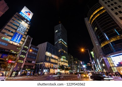 """MINATO, TOKYO / JAPAN - OCTOBER 21 2018 : Night view of """"Minami Aoyama"""" in Minato Ward. It is an area where luxury shops and modern buildings line up."""