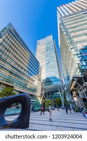 """MINATO, TOKYO / JAPAN - SEPTEMBER 28 2018 : Scenery of """"Tokyo Midtown"""" in Roppongi. A facility consisting of offices, hotels, commercial facilities, green spaces and residences, many people visit."""