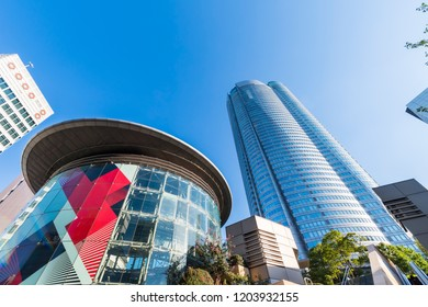 """MINATO, TOKYO / JAPAN - SEPTEMBER 28 2018 : Scenery of """"Roppongi Hills"""". Round shaped skyscrapers are landmarks. There are offices, commercial facilities, hotels, residences, TV stations and museums."""