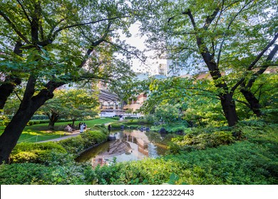 "MINATO, TOKYO / JAPAN - SEPTEMBER 28 2018 : Scenery of ""Mouri garden"" in Roppongi. It is a place where you can enjoy a walk in the Japanese garden with pond. It is near ""Roppongi Hills""."