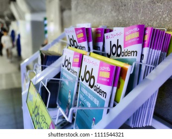 Minato-ku, Tokyo / Japan - May 24th 2016 : It's full employment period in Japan, some job offer magazines alone in a train station in Shimbashi.