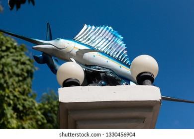 Minature Blue Marlin statue on post in Ao Nang, Krabi, Thailand against a blue sky. February 2019.