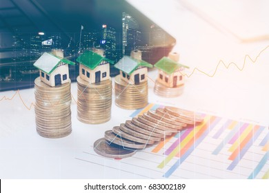 Minature houses resting on graph sheet coin stacks concept for property ladder, mortgage and real estate investment