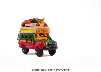 Minature model of a traditional Colombian bus (chiva). Sideview, white background.