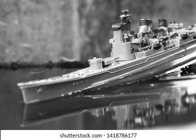 Minature plastic model ship in the water scene.