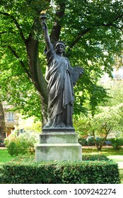 A minature version of the Statue of Liberty in the gardens of the Palace du Luxembourg in Paris, France