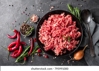 Mince. Ground meat with ingredients for cooking on black background. Top view - Shutterstock ID 795991000