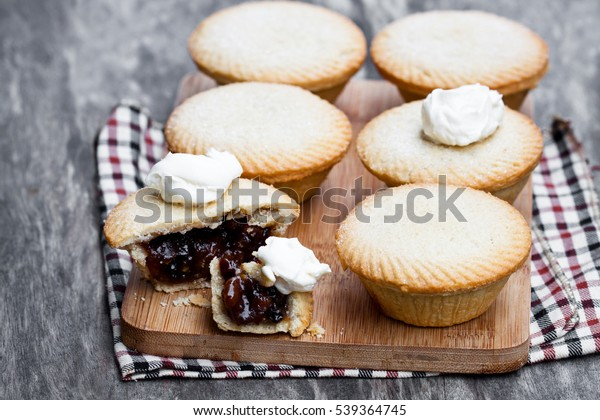 Mince  pie group on cutting board on wooden background