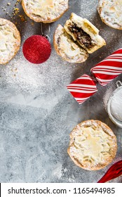 Mince pies, traditional christmas food made from all butter shortcrust pastry pies deep filled with plump vine fruits, such as cranberries, clementine, cherries and brandy, flat lay