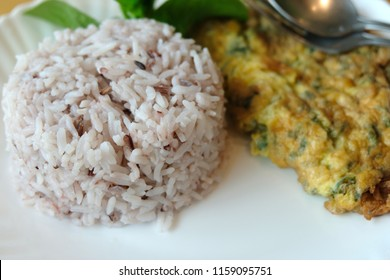 Mince pork omelet with rice on white dish