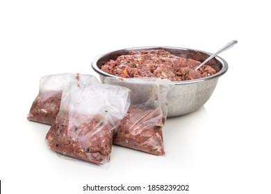 Minced barf raw food recipe for dogs consisting meat, organs, fish, eggs and vegetable are packaged for freezing for later consumption