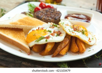 Minced beef on the grill, fried eggs sunny side up with bacon crumbs, crisp Irish , toast , wheat or rye.