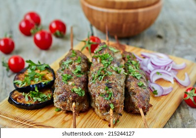Minced lamb kebab with vegetables