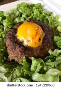 Minced meat with egg and salad