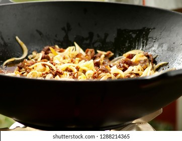 Minced meat and toasted onion in frying pan