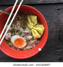 Minced-Pork Noodle Tomyam with pork ball and boiled-egg.