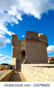 Minceta Tower of defense wall of Old town in Dubrovnik, Croatia with cloudy blue sky