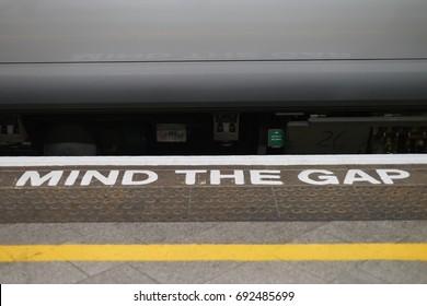 Mind the gap alert. Train station platform in United Kingdom.
