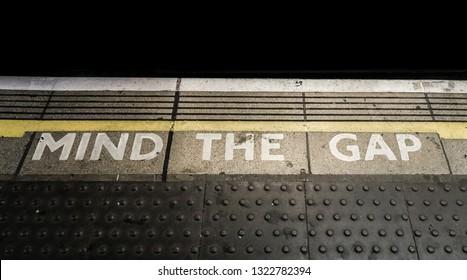 'Mind The Gap' painted on a platform on a London Underground station.