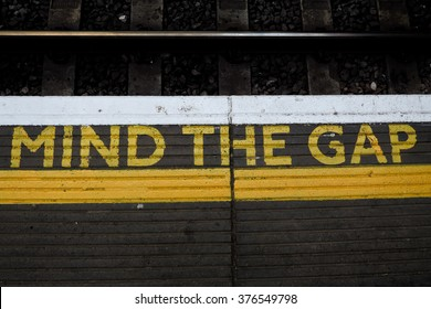 """Mind the gap"" is a warning to rail passengers in London to take caution while crossing the gap between the train door and the station platform."