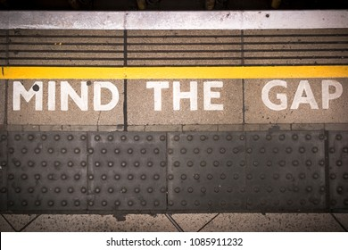 'mind the gap' written on the ground of the underground in london in subway