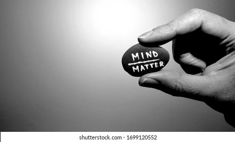Mind over Matter quote painted in white on a rock.