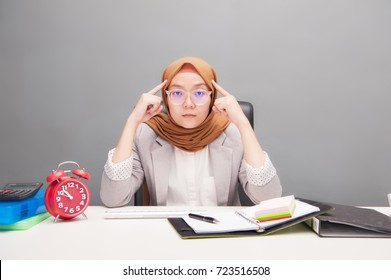 Mind Power concept.Business concept.A young business woman wearing hijab with mind power action with artificial grain effect.Business and financial.