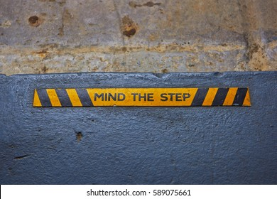Mind the Step warning banner on the pavement