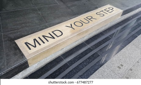 Mind your step word on the floor