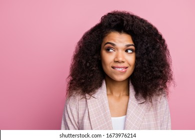 Minded charming stylish trendy afro american broker girl look copyspace want know colleagues secret chief promotion choice bite teeth lips wear plaid jacket isolated pink color background