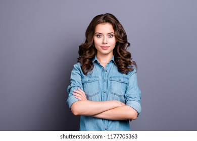 Minded nice charming tender attractive cheerful magnificent adorable brunette caucasian girl with wavy hair in casual denim shirt, folded arms, isolated over grey background