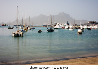 MINDELO, CAPE VERDE - DECEMBER 07, 2015: Boats and yachts in Marina of Sao Vicente island. Visible Face Mountian