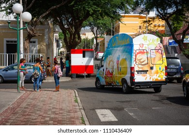MINDELO, CAPE VERDE - DECEMBER 07, 2015: Life in Mindelo, people on the streets and an Ice Cream truck