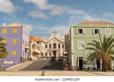 MINDELO, CAPE VERDE - OCTOBER 28, 2018: woman with a bag walking on the central square Praca Dom Luis in downtown Mindelo, Cape Verde on October 28, 2018.