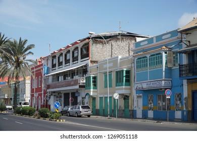 MINDELO, CAPE VERDE - OCTOBER 28, 2018: cars parked along Avenida Marginal in the historic center of Mindelo, Cape Verde on October 28, 2018.