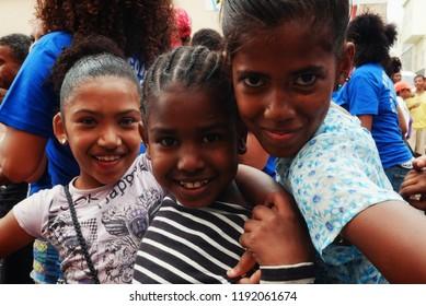 Mindelo, Sao Vicente Island, Cape Verde - Jan 5 2016: cute young girls enjoying the festival on the street