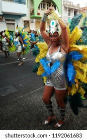 Mindelo, Sao Vicente Island, Cape Verde - Jan 5 2016: pretty woman dancer during the carnival show event in a dress with feathers