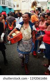 Mindelo, Sao Vicente Island, Cape Verde - Jan 5 2016: street seller during the carnival
