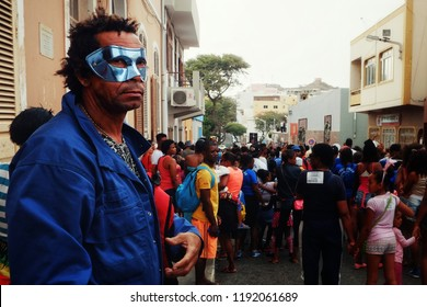 Mindelo, Sao Vicente Island, Cape Verde - Jan 5 2016: man with a mask watching the carnival event on the streets of the city