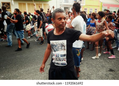 Mindelo, Sao Vicente Island, Cape Verde - Jan 5 2016: carnival crowd walking on the streets of the city