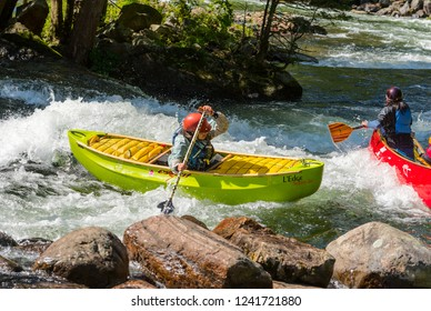 MINDEN, ONTARIO - SEPTEMBER 8, 2018: An unidentified female paddler in a whitewater canoe on a busy stretch of Gull River in Minden, Ontario, Canada.